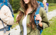 close up of woman with backpack hiking