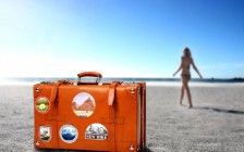 orange-color-suitcase-travel-beach-sand-horizon-girl-resort