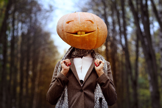 halloween girl with pumpkin head