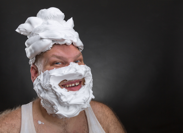 Funny man with shaving foam covered face